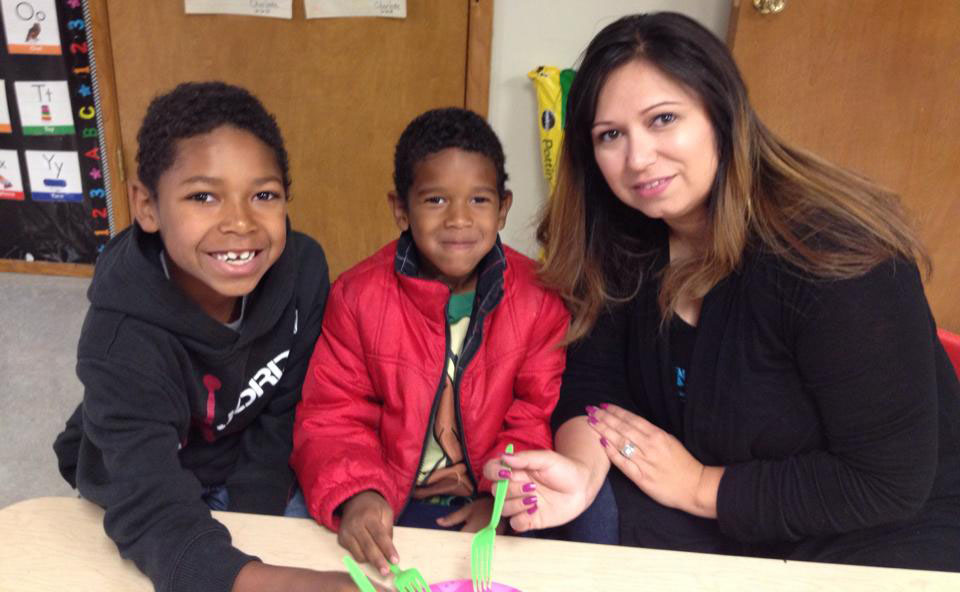 smiling african american boys with teacher at a Preschool & Daycare Serving Albuquerque NM