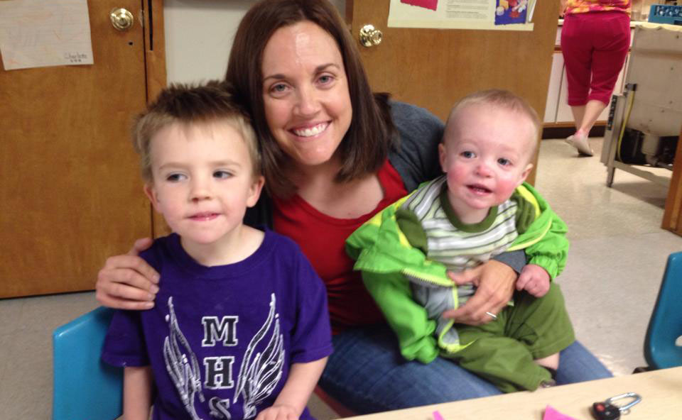 teacher with smiling baby and toddler at a Preschool & Daycare Serving Albuquerque NM