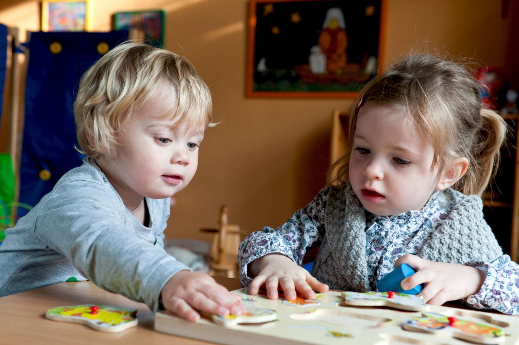 two children with puzzle at childcare serving Albuquerque NM