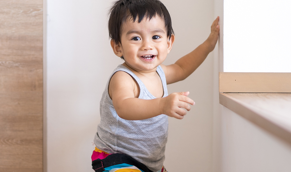 smiling asian infant at a Preschool & Daycare Childcare Center serving Albuquerque NM